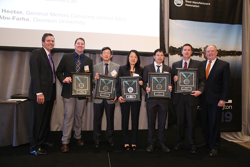 (L-R) Roger Newport, Chairman, AISI, Chief Executive Officer, AK Steel Corporation; Tyson Brown, General Motors Company; Yang Ren, Argonne National Lab; Xin Sun, Oak Ridge National Lab; Xiaohua Hu, Oak Ridge National Lab; Grant Thomas, AK Steel; Thomas J. Gibson, President and CEO, AISI