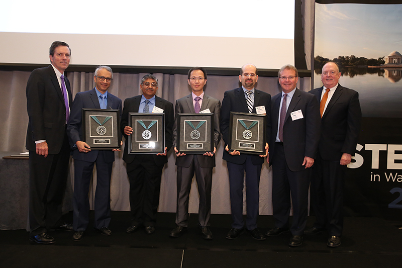 (L-R) Roger Newport, Chairman, AISI, Chief Executive Officer, AK Steel Corporation; Sriram Sadagopan, Group Manager, Applications Technology; Narayan Pottore, Principal Scientist, Product Development; Gang Huang, Lead Engineer, Applications Technology; Hassan Ghassemi-Armaki, Lead Engineer, Applications Technology; John Brett, Vice Chairman, AISI, President and CEO, ArcelorMittal USA; Thomas J. Gibson, President and CEO, AISI