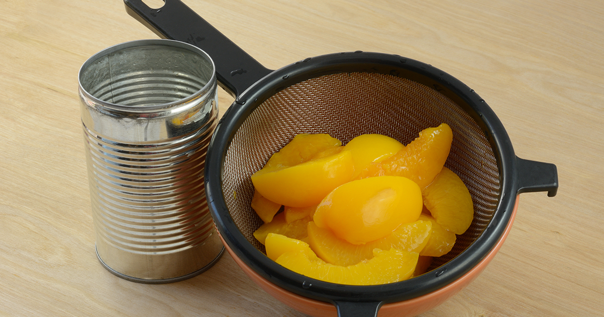 Steel canned peaches and strainer